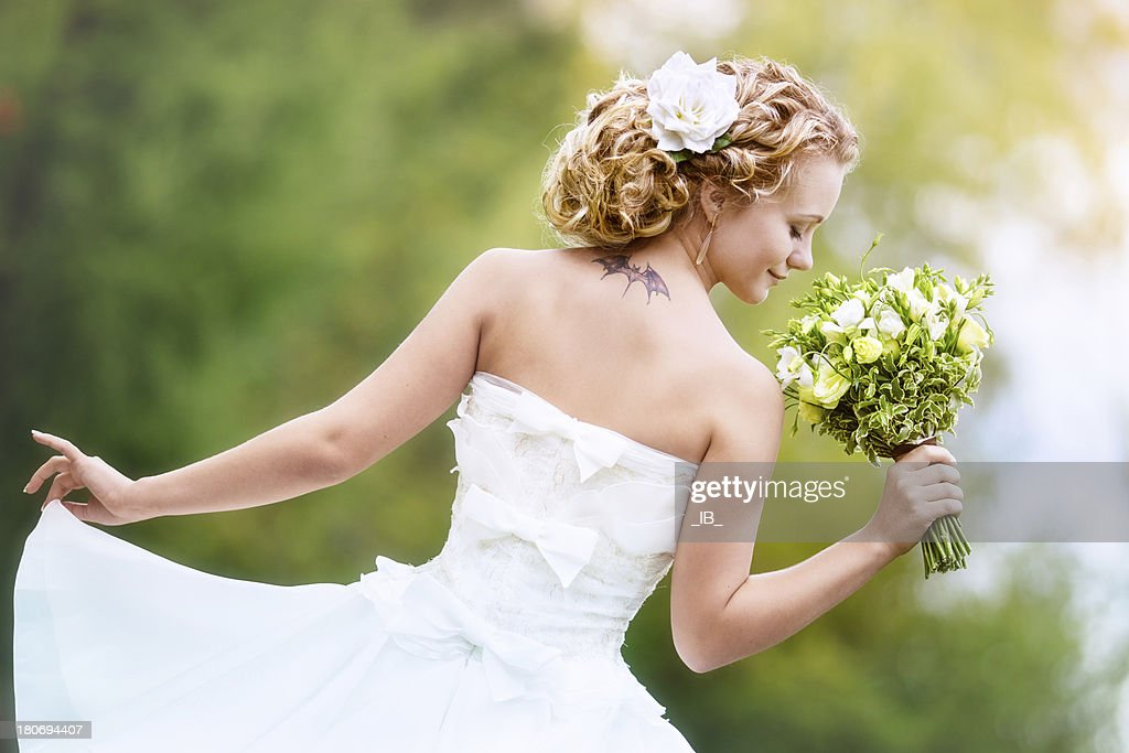 Portrait of charming bride with a bouquet : Stock Photo