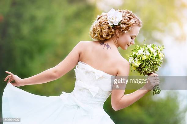 Portrait of charming bride with a bouquet