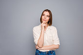 Portrait of charming nice youth work worker touch finger palms hands look have thoughts dressed fashionable modern youth clothes outfit isolated grey background