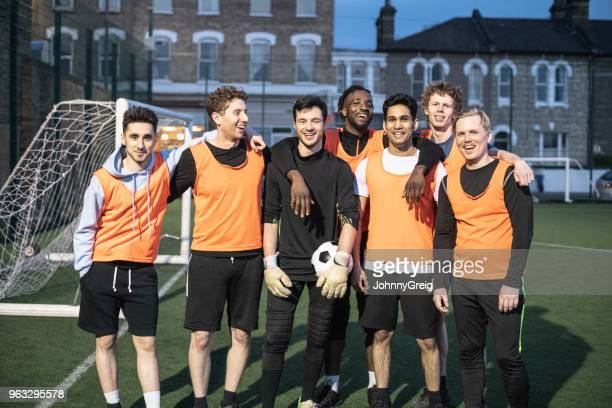 portrait of cheerful 7-aside football team - soccer team stock pictures, royalty-free photos & images