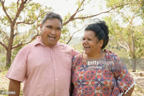 Portrait of cheerful Aboriginal mature couple