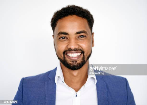portrait of cheerful african businessman in early 30s - open collar stock pictures, royalty-free photos & images