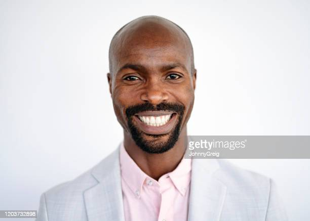portrait of cheerful african businessman in early 40s - goatee stock pictures, royalty-free photos & images