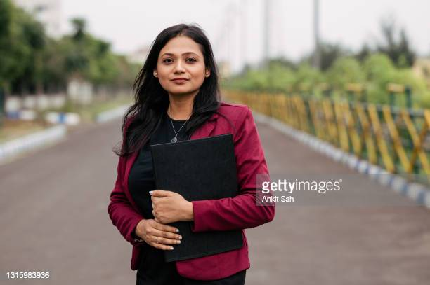 portrait of cheerful attractive indian young women in business were - businesswoman stock pictures, royalty-free photos & images