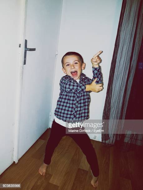 portrait of cheerful boy dancing at home - only boys stock pictures, royalty-free photos & images