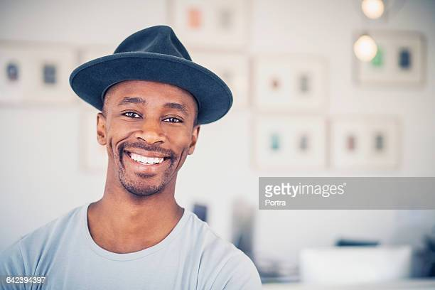 Portrait of cheerful businessman in office
