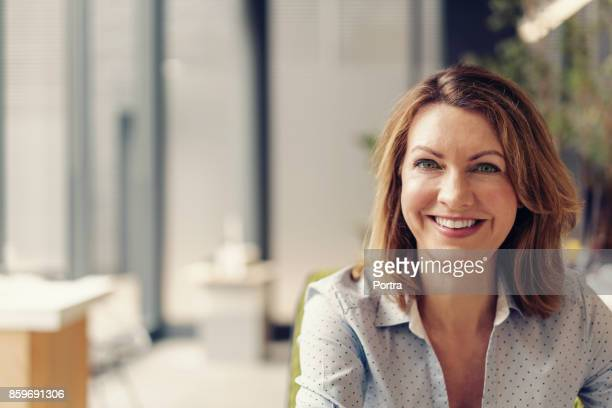Portrait of cheerful businesswoman at office