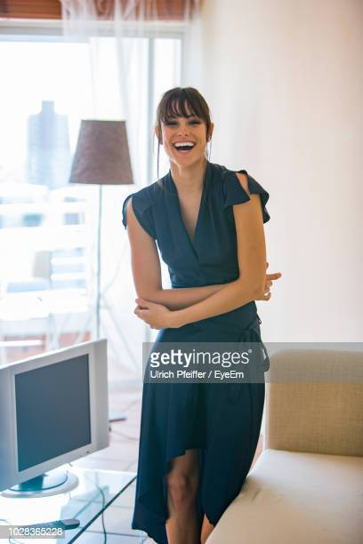 portrait of cheerful businesswoman standing at home - fringe dress stock photos and pictures