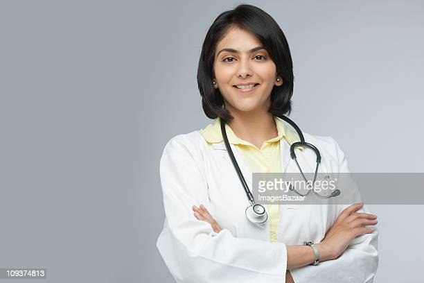 portrait of cheerful female doctor - indian subcontinent ethnicity stock pictures, royalty-free photos & images