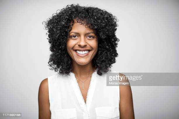 portrait of cheerful female owner with curly hair - portrait classique photos et images de collection