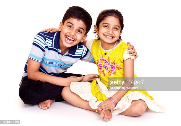 Portrait of Cheerful Indian Brother and Sister Isolated on White