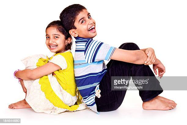 portrait of cheerful indian brother and sister isolated on white - little girls bare bum stock pictures, royalty-free photos & images