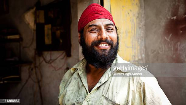Portrait of Cheerful Indian Sikh Mechanic Manual Worker