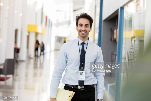portrait of cheerful male high school teacher on first day of school - school principal stock pictures, royalty-free photos & images