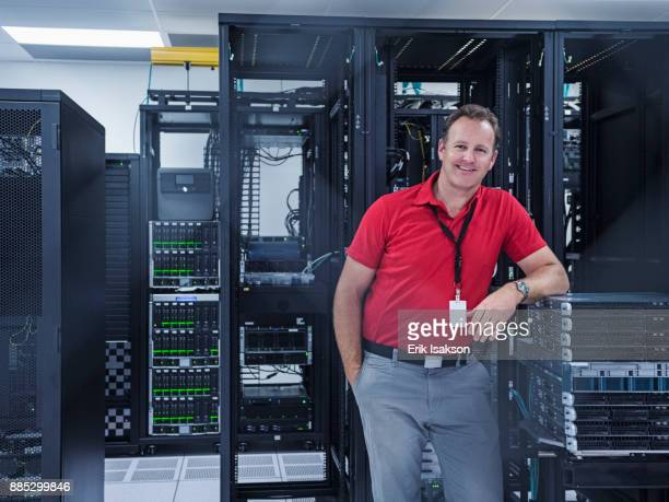 Portrait of cheerful man in server room