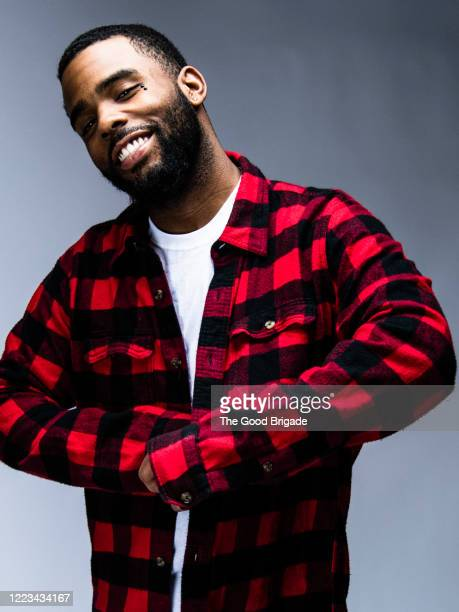 portrait of cheerful man wearing plaid shirt - plaid shirt stock pictures, royalty-free photos & images