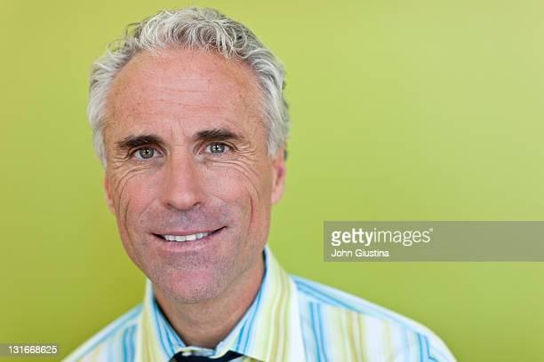 Portrait of cheerful mature businessman