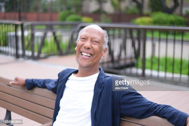 portrait of cheerful mature man - gender fluid stock photos and pictures