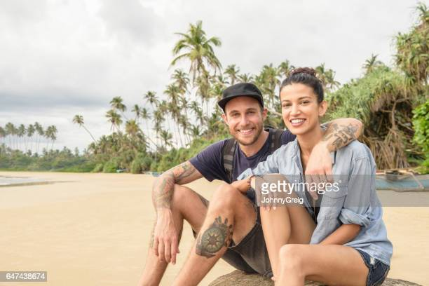 Portrait of cheerful mid adult couple on vacation, smiling