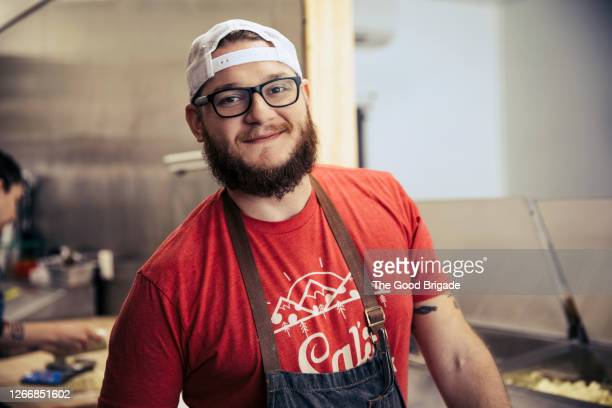portrait of cheerful pizza chef - chef stock pictures, royalty-free photos & images
