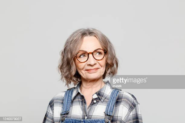 portrait of cheerful senior woman wearing checkered shirt - spectacles stock pictures, royalty-free photos & images