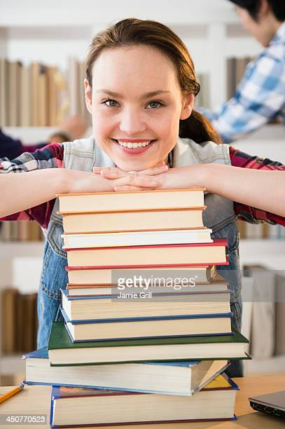 Portrait of cheerful student in library