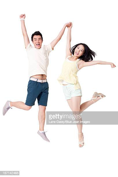 Portrait of cheerful young people jumping