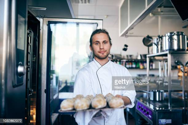 Portrait of chef baking breads in commercial kitchen