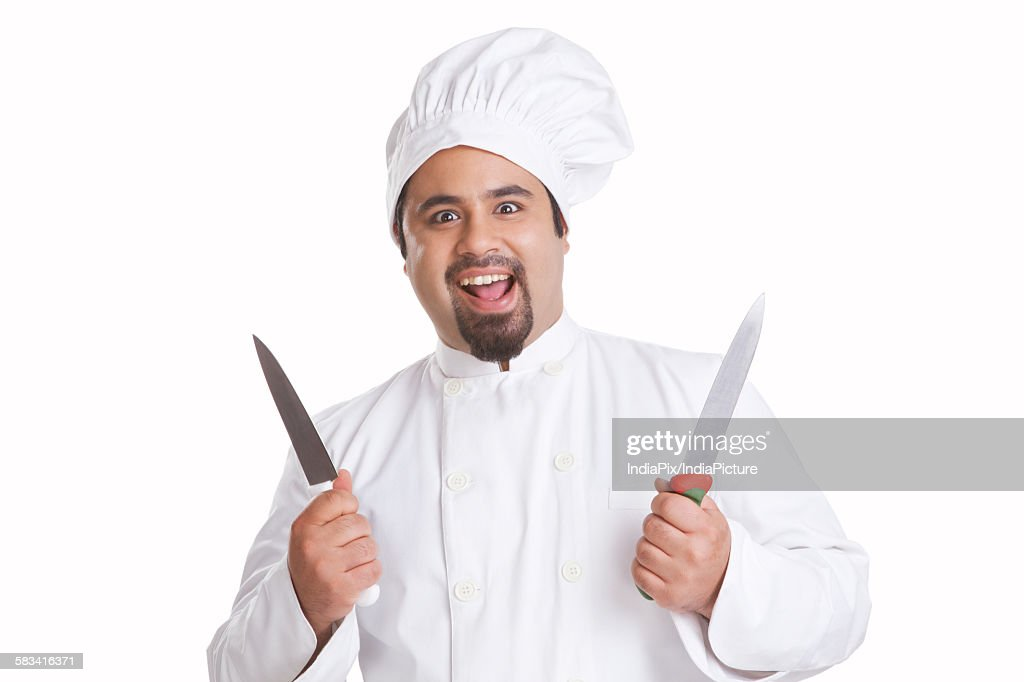 Portrait of chef holding knives : Stock Photo