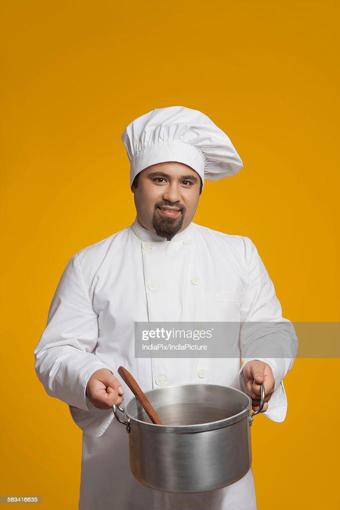 Portrait of chef holding utensil : Stock Photo