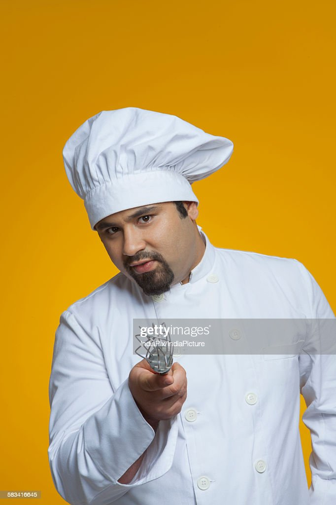 Portrait of chef holding wire whisk : Stock Photo