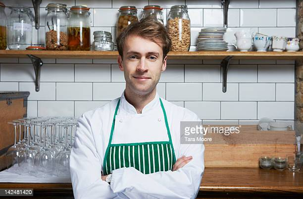 portrait of chef in restaurant - apron stock pictures, royalty-free photos & images