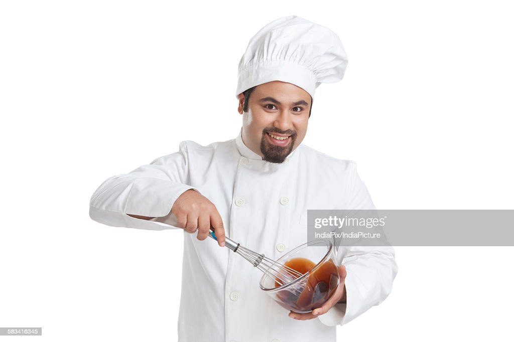 Portrait of chef mixing chocolate in a bowl : Stock Photo