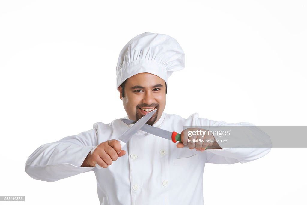 Portrait of chef sharpening knives : Stock Photo