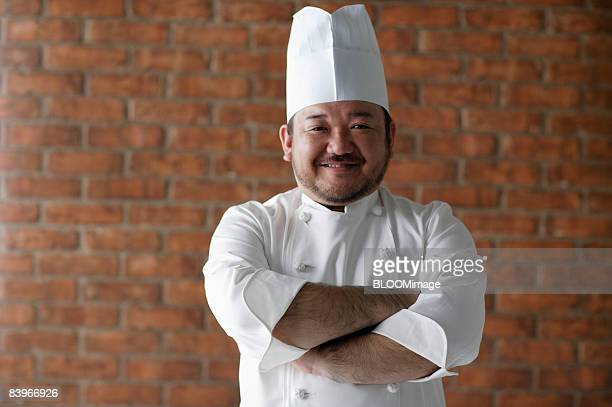 Portrait of chef, with arms folded