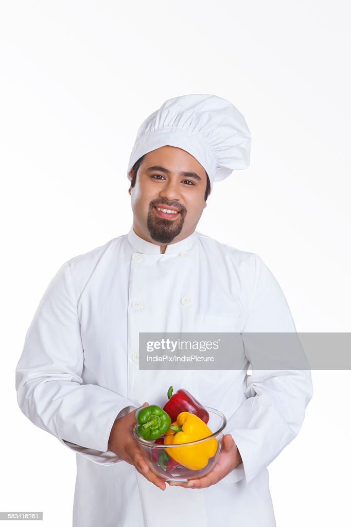 Portrait of chef with bowl of capsicum : Stock Photo