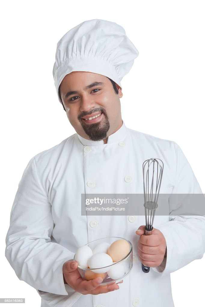 Portrait of chef with bowl of eggs : Stock Photo