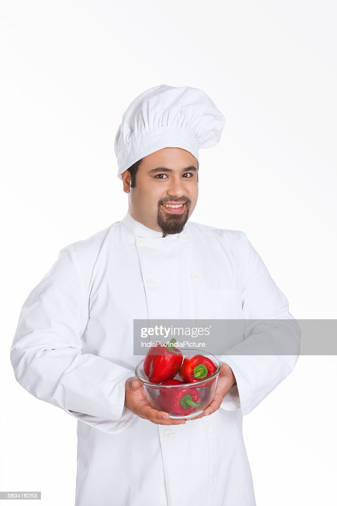 Portrait of chef with bowl of red capsicum : Stock Photo