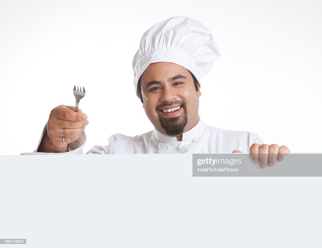 Portrait of chef with fork smiling : Stock Photo