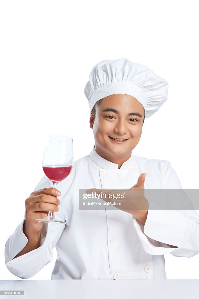 Portrait of chef with glass of wine : Stock Photo