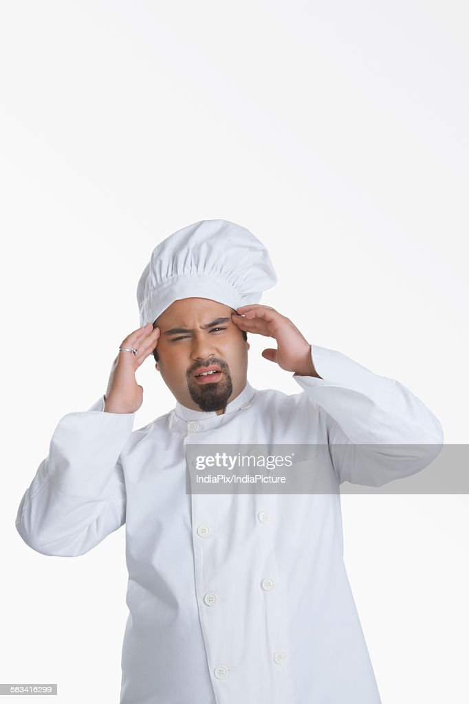 Portrait of chef with headache : Stock Photo