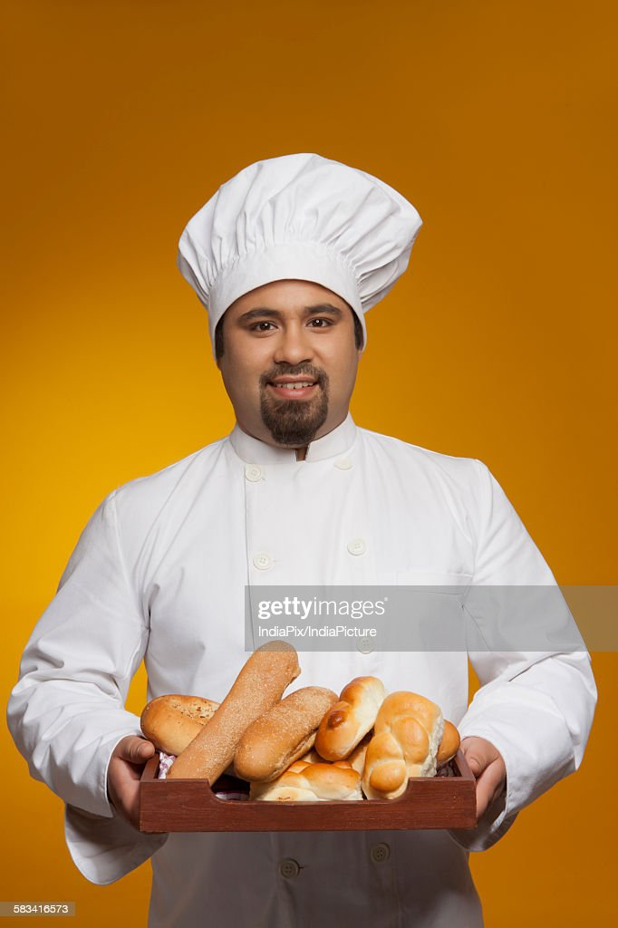 Portrait of chef with tray of bread : Stock Photo