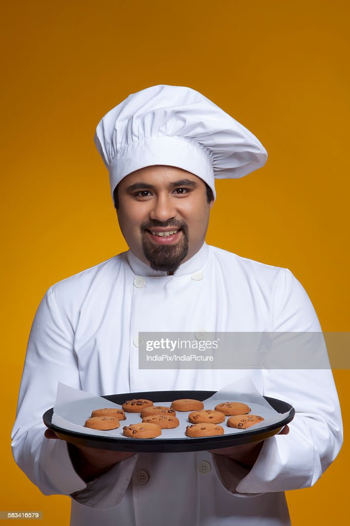 Portrait of chef with tray of cookies : Stock Photo