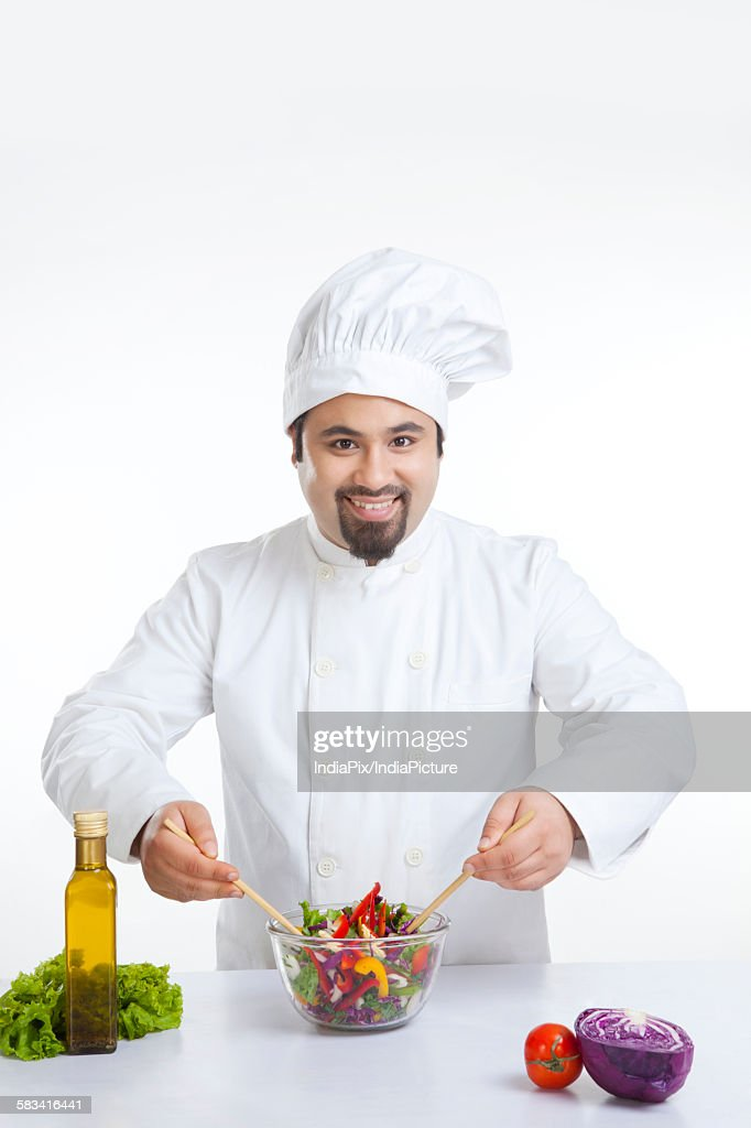 Portrait of chef with vegetables in bowl : Stock Photo