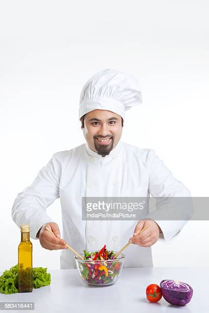 Portrait of chef with vegetables in bowl