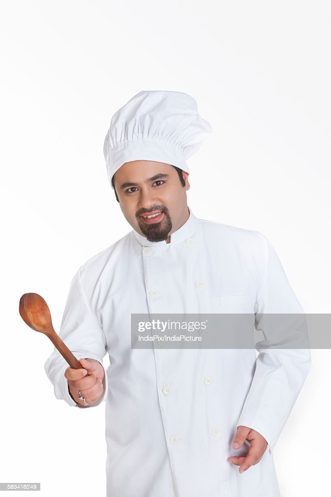 Portrait of chef with wooden spoon : Stock Photo