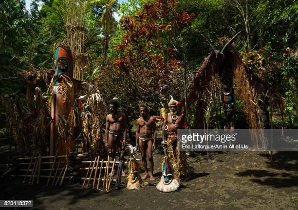 Portrait of chieftain Etul and his sons in front of the nakamal Ambrym island Fanla Vanuatu on August 29 2007 in Fanla Vanuatu