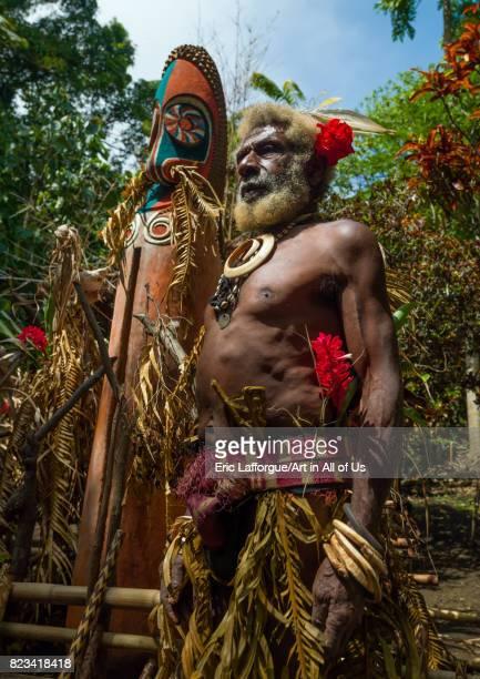 Portrait of chieftain Etul in front of a giant slit drum Ambrym island Fanla Vanuatu on August 29 2007 in Fanla Vanuatu