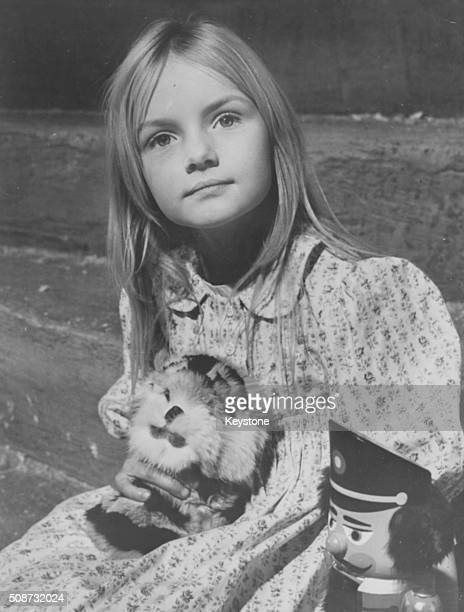 Portrait of child actress Heather Ripley playing with toys in the set of film 'Chitty Chitty Bang Bang' circa 1967