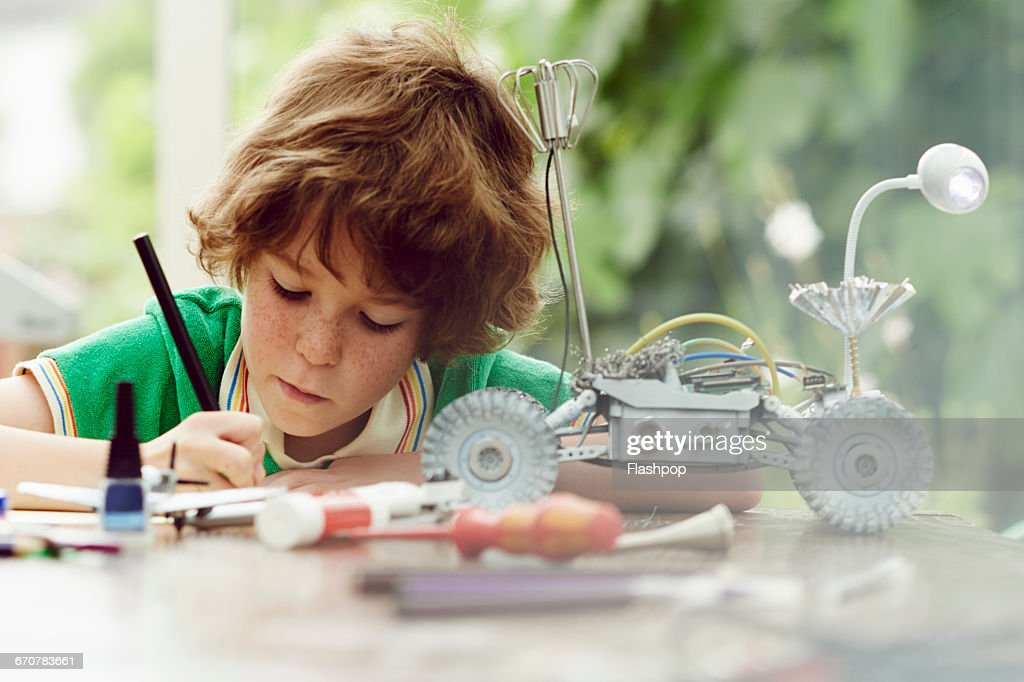 Portrait of child being creative and making things : Stock Photo